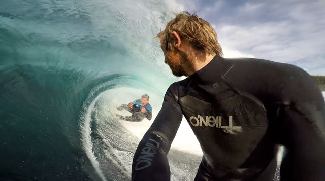 Leroy Bellet doing standard double tow surf photography.