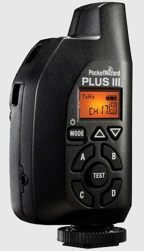 The PocketWizard Plus III stands vertically.