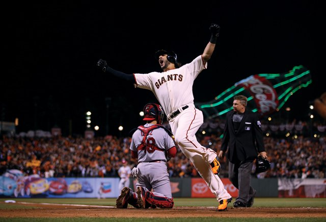 Michael Morse celebrates after hitting pinch-hit home run in Game 5 of NLCS, 2014 World Series Champion Giants. Photo by Brad Mangin.
