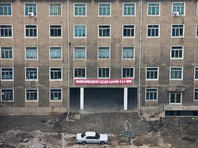 Pyongyang is supposed to look grand and modern in photos, so photographing run-down buildings is a big no-no.