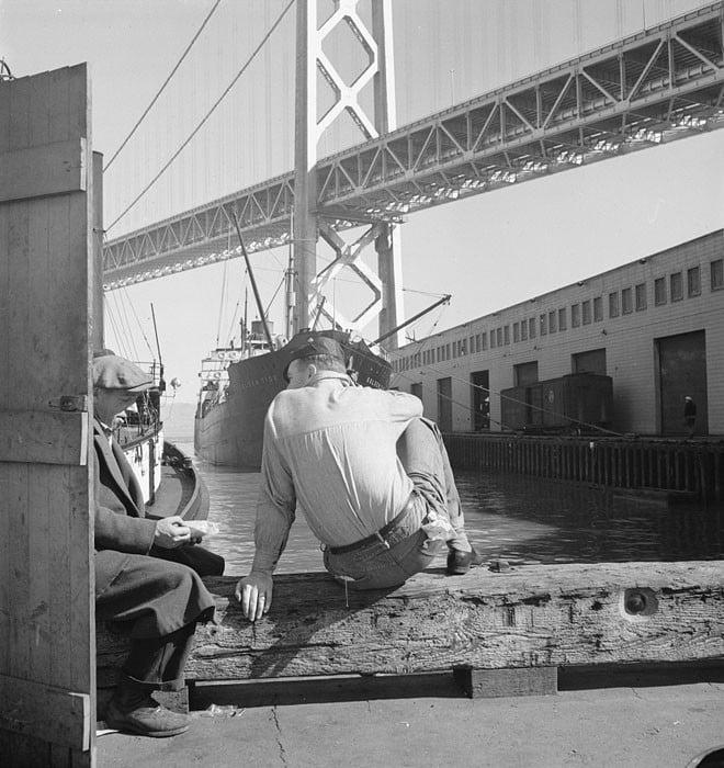 Longshoremen's lunch hour. San Francisco waterfront, California. February 1937.