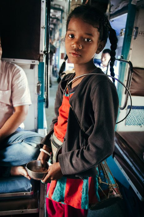 A young acrobat boarded the train at Jagiroad, Assam, performing an astonishing floor routine of tumbles and cartwheels down the aisle, hoping for donations.