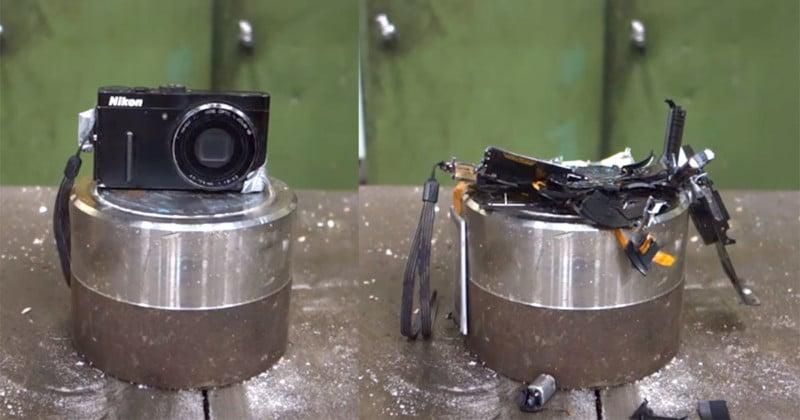 watch a nikon p300 camera get flattened by a hydraulic press