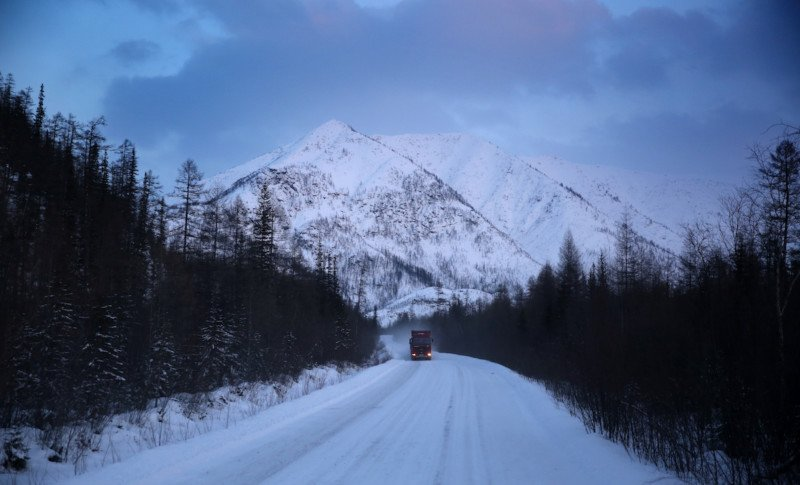 "A truck heading through the Verkhoyansk mountains. The first half of the journey to Belaya Gora is along the Kolyma Highway, known as the ""Road of Bones""."