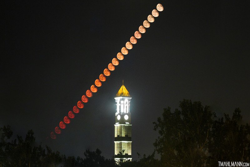 The very next day, aligning perfectly – the moon over Purdue Bell Tower