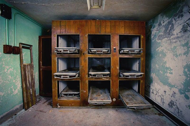 An antique wooden morgue fridge