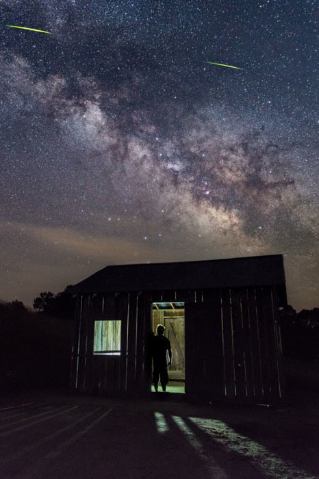 This is two exposures, the sky was a tracked shot using the astrotracer on the Pentax K-3II but it could easily be done in one shot.  The inside of the shack was lit using an LED panel on a tripod with the dimmest setting.  It is a 20 second exposure at ISO 3200, f/2.8 and the light remained on while I stood still for the entire 20 seconds. (Those yellow streaks at the top are fire flies)