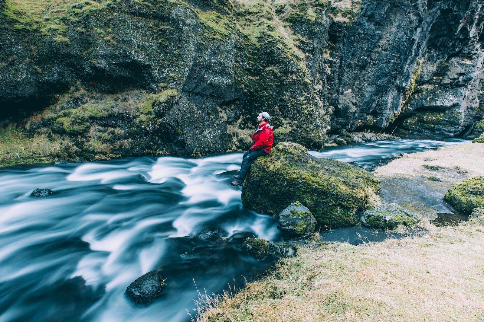 iceland-river-man-on-rock