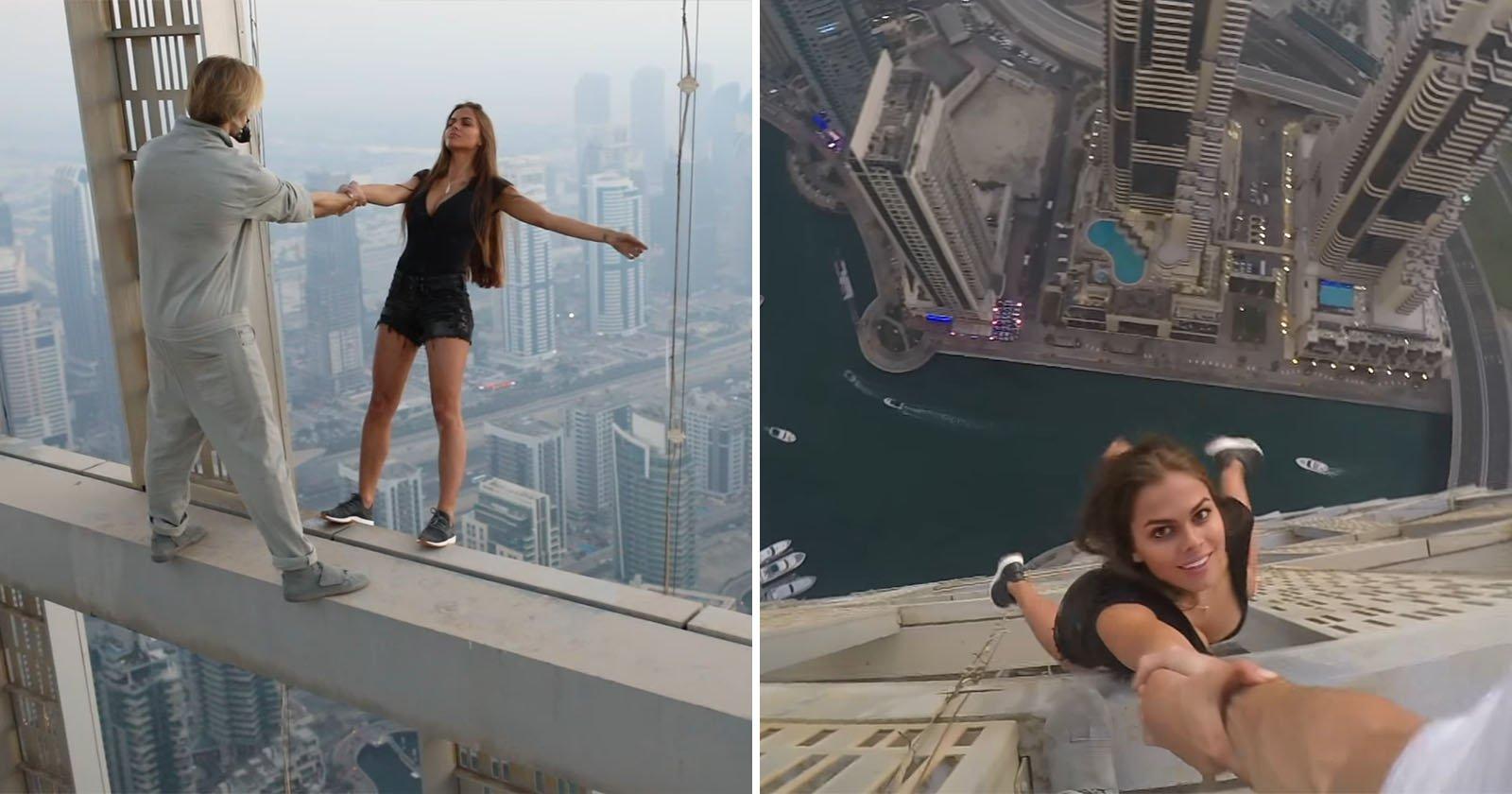 model dangled off 1000ft skyscraper for reckless photo shoot