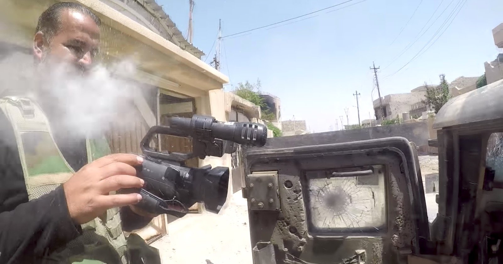 Video: Journalist's Chest Mounted GoPro Deflects Sniper Bullet