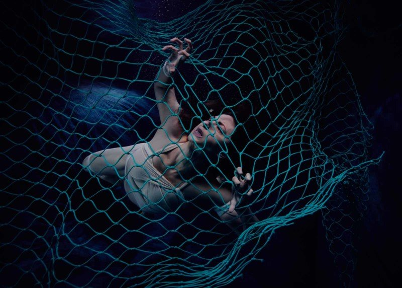 Underwater Photos of Woman in a Net Show the Horrors of Ghost Fishing