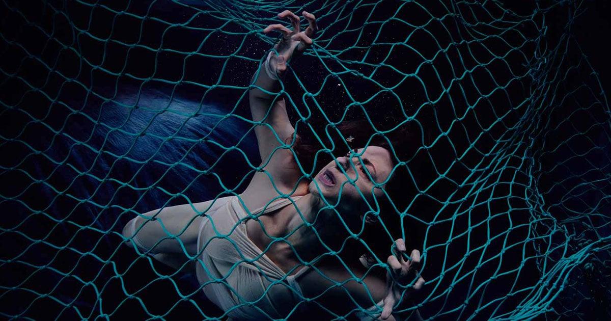 Girl in fishing net playing herself 3