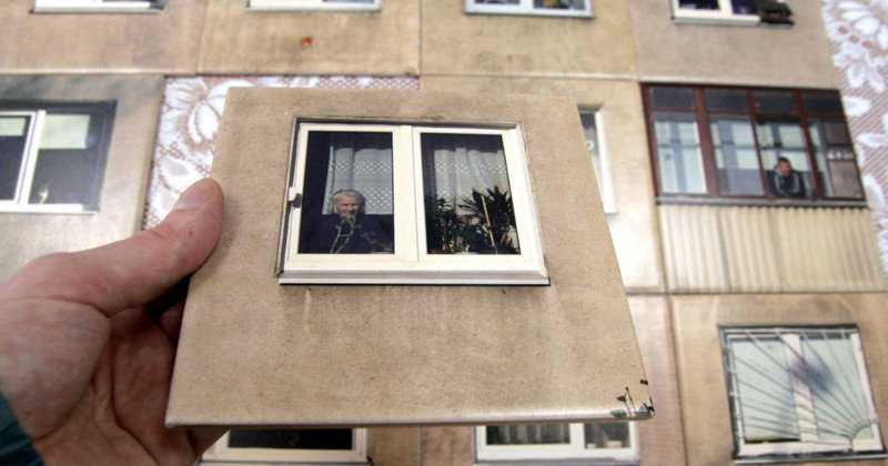 Here S An Unusual Way To Decorate A Wall With Photos The Lithuanian Design Studio Gyva Grafika Printed Of Apartment Windows Onto Tiles