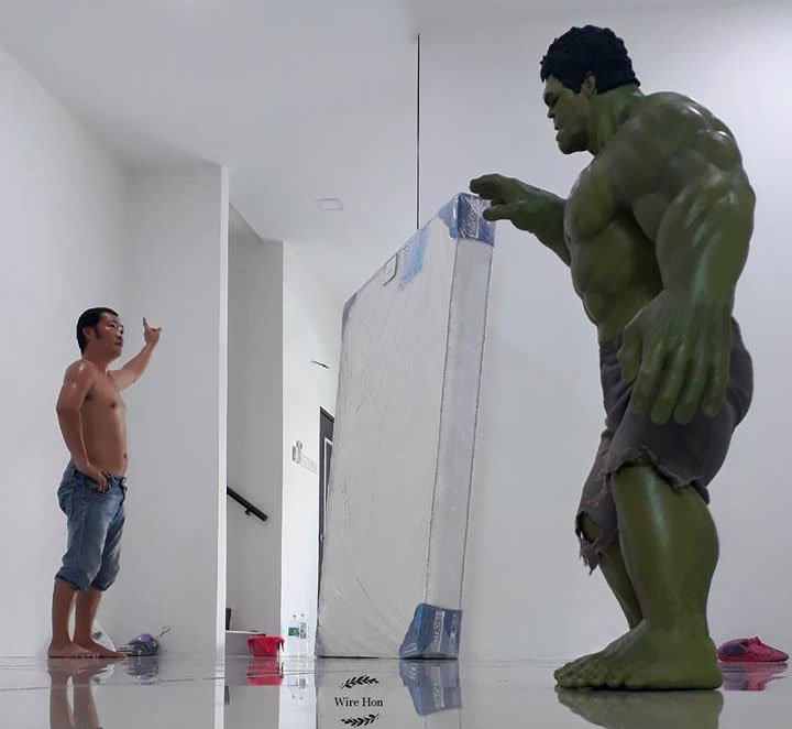 This Guy Poses with Toy Superheroes Using Forced Perspective