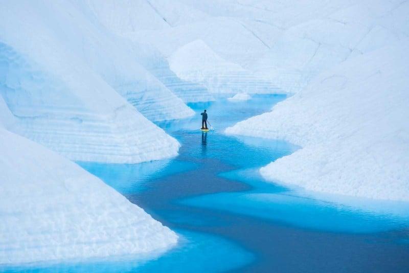Photos of a Paddleboarder Gliding Through Alaskan Glaciers