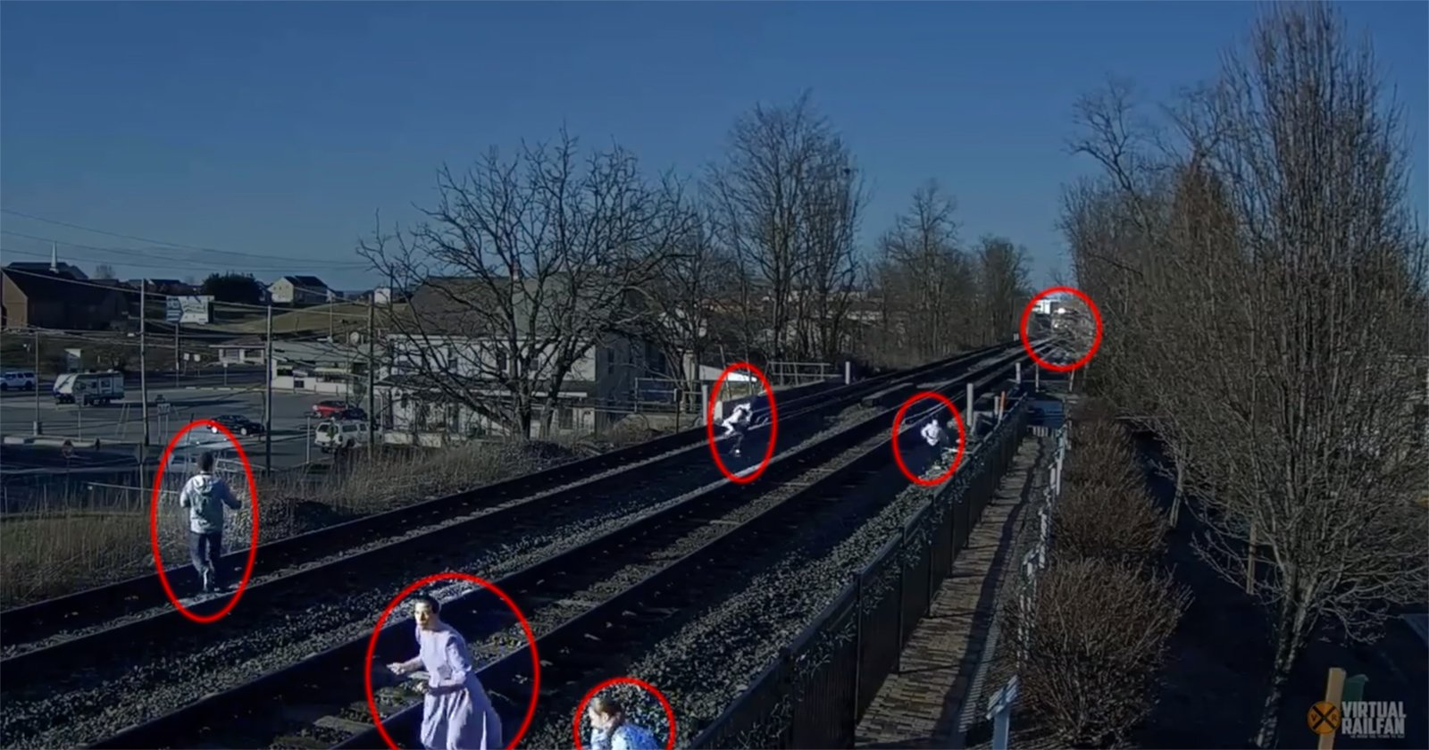 Video: Family Narrowly Avoids Getting Hit by Train During Photo Shoot