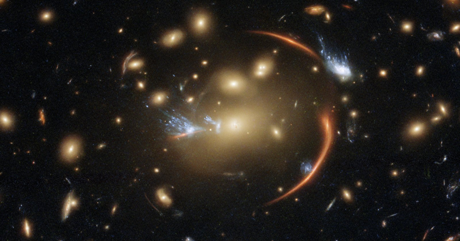 This Galaxy is 10 Billion Light Years Away, Visible Through a Cosmic Lens