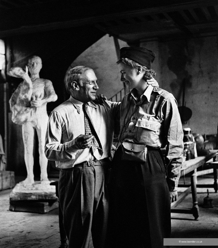 """Picasso and Lee Miller in the artist's studio during the liberation of Paris. Picasso embraced Lee Miller with effusive warmth, declaring: """"This is marvelous, this is the first Allied soldier I have seen, and it's you!"""" Published: 1. UK Vogue, October 1944. 2. Portrait of Picasso by Roland Penrose 1971 Fig 175 P68 Captioned as: Picasso and Lee Miller. Published in Portrait of Picasso by Roland Penrose, 1956, page 66 and in Portrait of Picasso by Roland Penrose, 1956 (reprinted 1971), page 68, Lund Humphries, London. Captioned as: Picasso at rue des Grands Augustins with Lee Miller, first Allied correspondent to call on him after the liberation of Paris. Published in Visiting Picasso - The Notebooks and letters of Roland Penrose by Elizabeth Cowling, 2008, front cover and page 52, Thames & Hudson, London. Published in Scrap Book by Roland Penrose, 1981, page 136, La Poligrafa, Barcelona."""