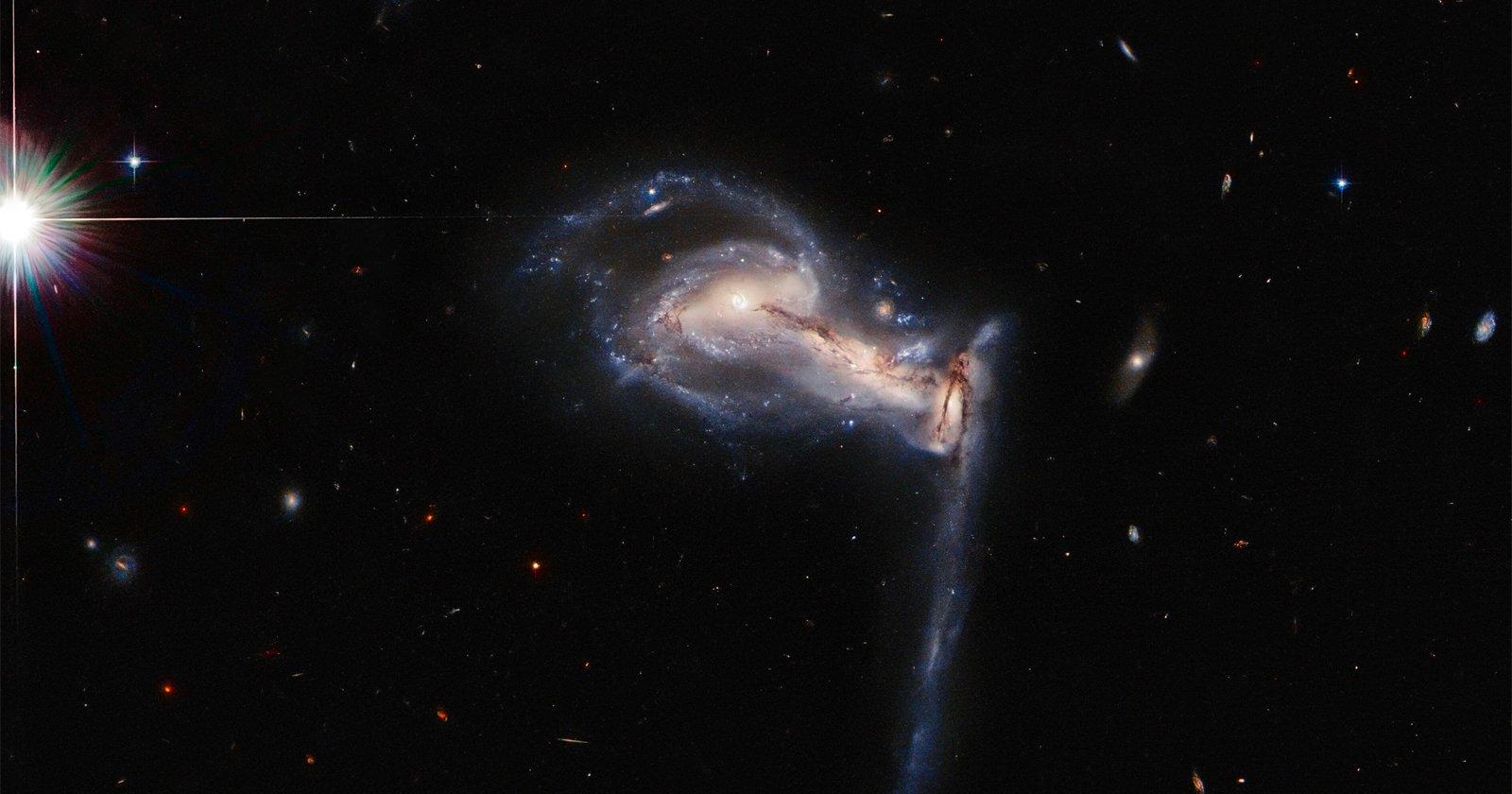 Hubble Captures 'Gravitational Tug-of-War' Between Three Galaxies